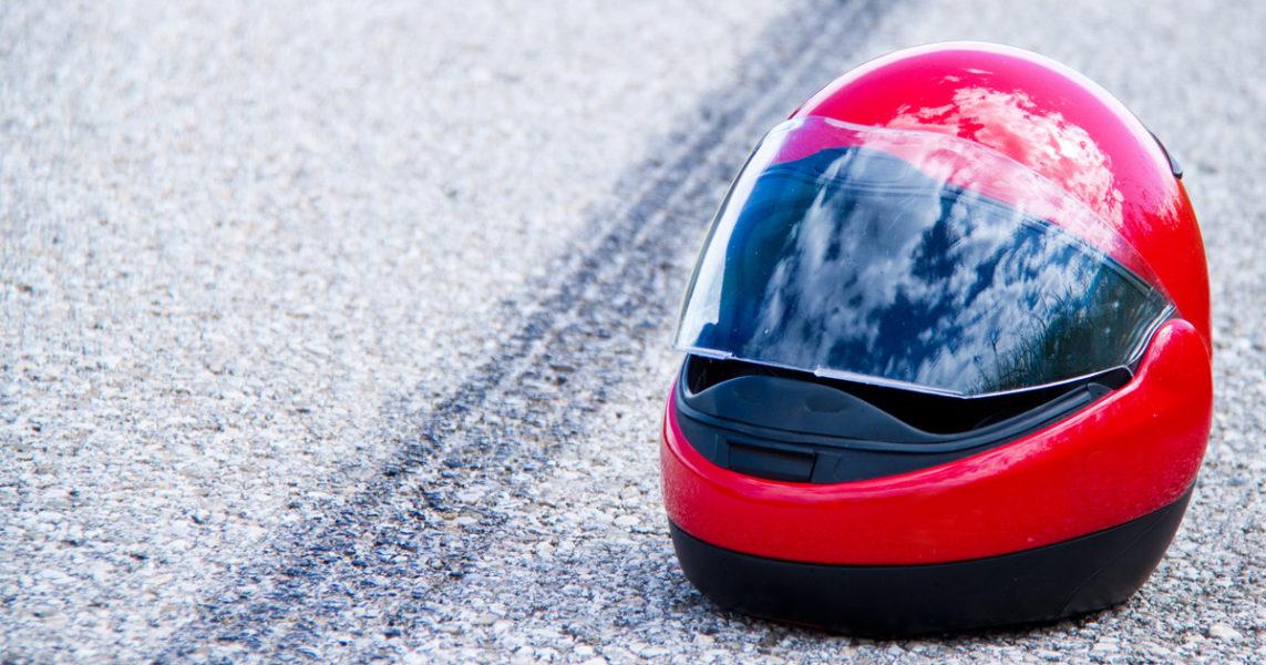Helmet on side of the road
